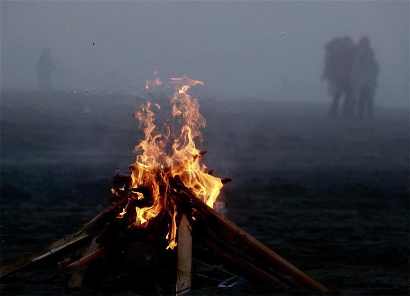هنر عکاسی دود و آتش Ara شعله هاى انتظار و امید( صید ماهى در ساحل دریاى خزر)