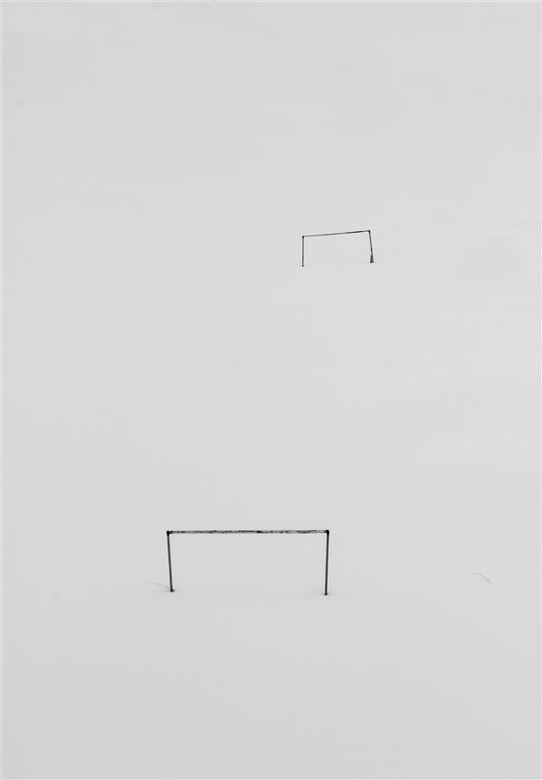هنر عکاسی محفل عکاسی پیمان ملایی زمین فوتبال پوشیده از برف
