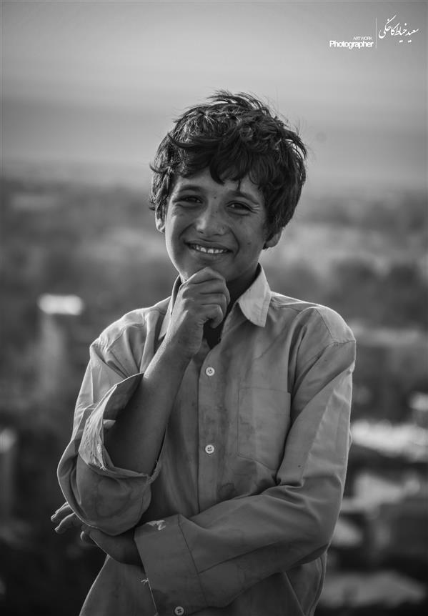 هنر عکاسی محفل عکاسی سعید خیاط کاخکی #فقر در حاشیه شهر #لبخند #کودک #خنده