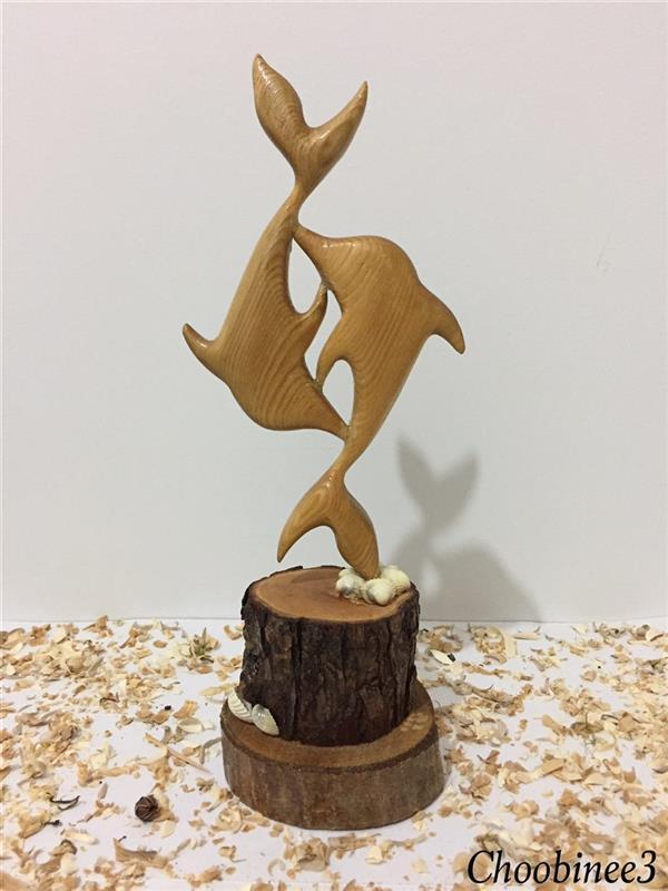هنر سایر محفل سایر هنر ها رضا موسی خانی دلفین های چوبی. ارتفاع اثر 30 سانتیمتر
