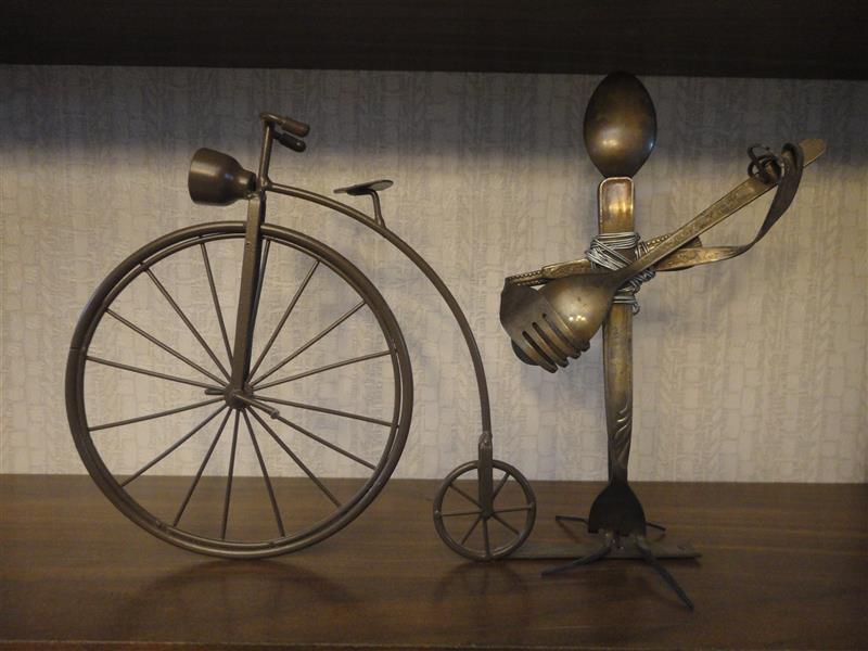 هنر سایر محفل سایر هنر ها سحر داسدار مجسم فلزی ابعاد حدودی 20* 30