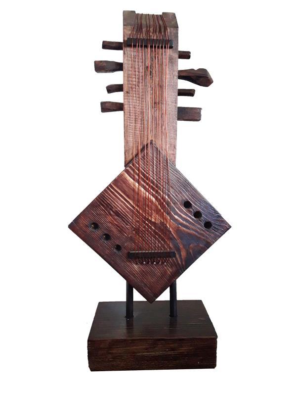 هنر سایر محفل سایر هنر ها رحمان احمدی ملکی #عنوان: آهنگ ترنج ( از مجموعه سمفونی سکوت) #ترکیب مواد( چوب و فلز) #هنرمند: رحمان احمدی ملکی