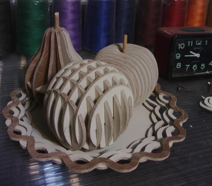 هنر سایر محفل سایر هنر ها بهمن بیدقی # ظرف میوه # ساخته شده از تخته سه لا ، سیب ( لایه لایه ) ، پرتقال و گلابی ( فاق و زبانه )