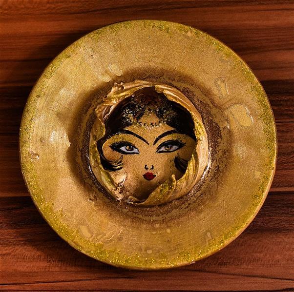 هنر سایر محفل سایر هنر ها Hadiskhaefi #بشقاب برجسته رو میزی خورشید  ابعاد:۲۰ سانتی متر تکنیک اثر:#اکریلیک،#پودر#طلا  نام هنرمند:حدیث خائفی