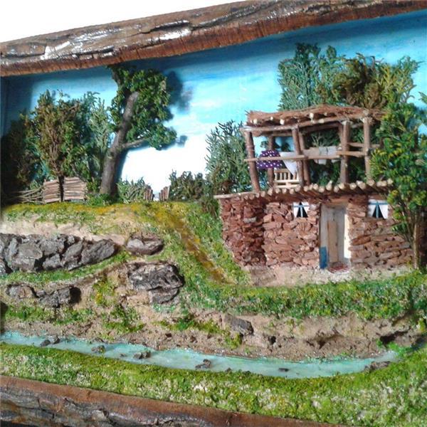 هنر سایر محفل سایر هنر ها گالری هیمه نمایی دیگر از تابلو برجسته منظره روستایی در کرمانشاه  ساخته شده از چوب و فرآورده های چوبی ومواد طبیعی ابعاد ۴۵*۶۰ سانتیمتر