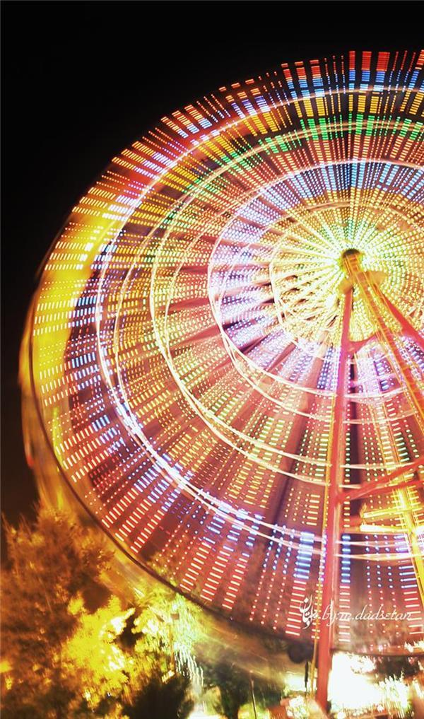 هنر عکاسی عکاسی در شب محمد دادستان عنوان: هندسه ی نور ۲ تکنیک: ICM مکان: تهران، پارک اِرم #city #my_city #carousel #colorful #amusement_park #eram_park #icm